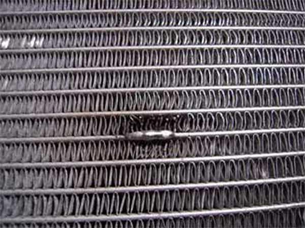 Место устранения течи алюминиевого радиатора с помощью пайки