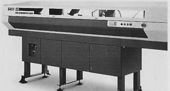 Программно-управляемое устройство подачи круглого проката или толстостенных труб через отверстие в шпинделе