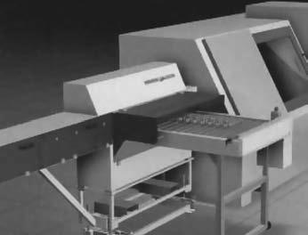 Программно-управляемое устройство подачи штучных заготовок через отверстие в шпинделе