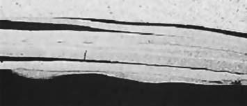 Расслоение материала на тонкие слои на периферии отверстий